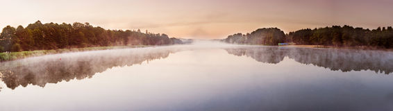Sunrise over the misty lake panorama Royalty Free Stock Image
