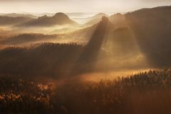 Sunrise Over Misty Landscape. Scenic View Of Foggy Morning Sky With Rising Sun Above Misty Forest. stock photo