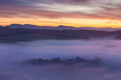 Free Sunrise Over Misty Landscape. Scenic View Of Foggy Morning Sky With Rising Sun Above Misty Forest. Middle Summer Nature Of Europe. Royalty Free Stock Images - 141353979