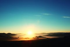 Sunrise over misty mountains Royalty Free Stock Photo