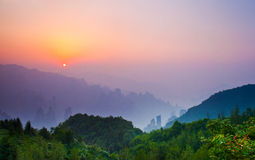 Sunrise over misty mountains, Zhangjiajie China Stock Photography