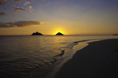 Sunrise over the mokulua islands Stock Photography