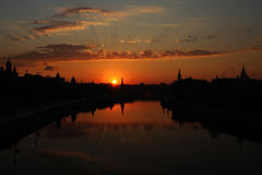 Sunrise over Moscow Kremlin. Sunrise over the Moscow Kremlin embankment. The first rays light up the sky Stock Photos