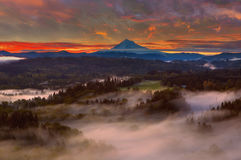 Sunrise over Mount Hood and Sandy River Valley. Foggy sunrise over Mount Hood and Sandy River Valley from Jonsrud Viewpoint in Sandy Oregon Stock Photography
