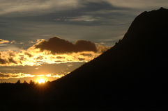 Sunrise over a mountain royalty free stock image