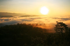 Sunrise over mountain and fog Stock Photography