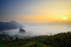 Sunrise over mountain and fog Royalty Free Stock Images