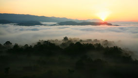 Sunrise over mountain and fog Stock Image