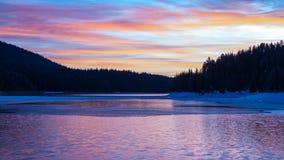 Sunrise over a mountain lake Stock Image