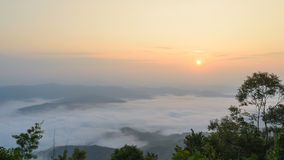 Sunrise over mountain and mist in the morning at nan thailand Stock Images