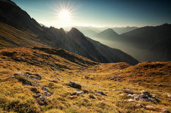 Sunrise over mountain peaks Stock Image