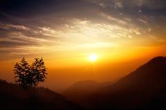 Sunrise over mountain range Stock Photos