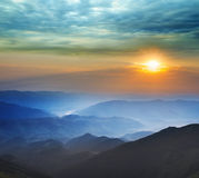 Sunrise over a mountain valley Royalty Free Stock Image