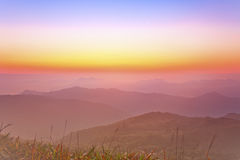 Sunrise over a mountain valley Stock Images