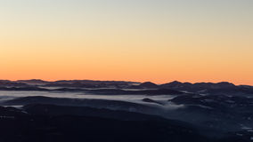 Sunrise over the mountains Stock Photography