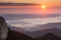 Sunrise over mountains and clouds Stock Image