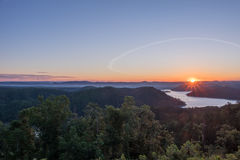 Sunrise over the mountains and a lake in HDR. Summer time sunrise over the mountains in HDR Stock Images