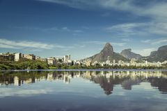 Sunrise over mountains in Rio de Janeiro with water reflection Royalty Free Stock Photo