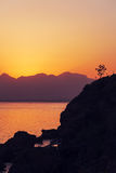 Sunrise over the mountains and the sea Stock Photography