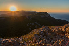 Sunrise over the mountains of Southern Crimea. View from top of Mount Ilyas Kaya. Laspi Bay. Stock Photos