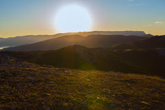 Sunrise over mountains of Southern Crimea. View from top of the mountain Ilyas Kaya. Sunrise over the mountains of the Southern Crimea. View from the top of the Stock Image