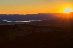 Sunrise over mountains of Southern Crimea. View from top of the mountain Ilyas Kaya. Sunrise over the mountains of the Southern Crimea. View from the top of the Stock Photo