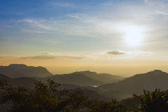 Sunrise over mountains under mist in the morning at Khao Kho Nat Royalty Free Stock Photos