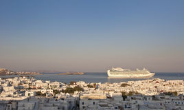 Sunrise over Mykonos and cruise liner Stock Photography