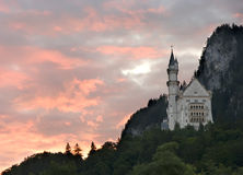 Sunrise over Neuschwanstein. The sunrise over a famous romantic castle Neuschwanstein in Germany, Bavaria Royalty Free Stock Photos