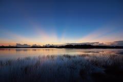 Sunrise over Nine Mile Pond in Everglades National Park. Sunrise with distinct sun rays over Nine Mile Pond in Everglades National Park, Florida stock photos