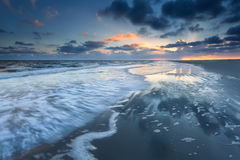 Sunrise over North sea coast during low tide Royalty Free Stock Images
