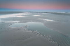 Sunrise over North sea coast at low tide Stock Images