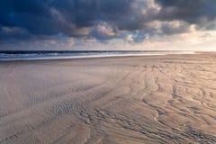 Sunrise over North sea sand beach Stock Images