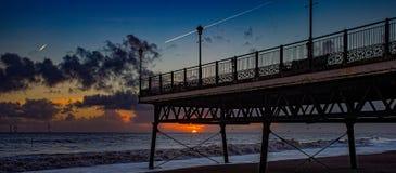 Sunrise under the pier. Stock Photo