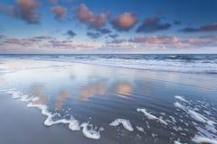 Sunrise over North sea waves Stock Photo