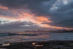 Sunrise over northeastern Mallorca. The sun rising over Cap Farrutx as seen from Son Baulo in northern Mallorca, Spain royalty free stock photo