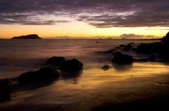 Sunrise over the ocean. Beautiful Sunrise On The Ocean Shore Royalty Free Stock Image