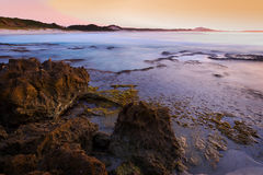 Sunrise over the Ocean. A classic coastal scene presents itself at first light in Australia Stock Image