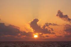 Sunrise over the ocean. An early morning, orange sunrise over the ocean Royalty Free Stock Image