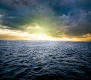 Sunrise over ocean. A sunrise over dark water of ocean Royalty Free Stock Photo