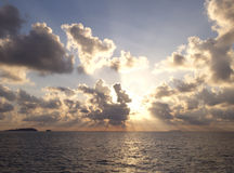 Sunrise over the ocean. Dramatic sunrise over the ocean with islands on the horizon Royalty Free Stock Images