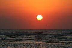 Sunrise Over Ocean. Sun rising over ocean with red sky Stock Photo
