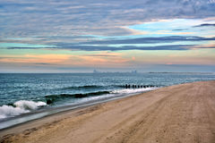 Sunrise Over Ocean and Atlantic City. The sunrises over the ocean with Atlantic City off in the distance Stock Images