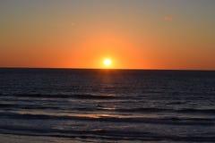 Sunrise over the Ocean at the Beach Stock Photos
