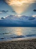 Sunrise over the ocean beach. Serene sunrise over the ocean beach Royalty Free Stock Photo