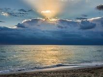 Sunrise over the ocean beach. Serene sunrise over the ocean beach Stock Photos