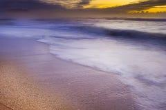 Sunrise over the Ocean. A beautiful sunrise over a deserted beach Stock Photos