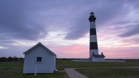 Sunrise Over The Ocean Behind the Bodie Island Lighhouse OBX stock photography