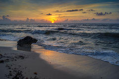 Sunrise over ocean with breaking waves. Sunrises over the Caribbean island of Cozumel, Mexico stock photography