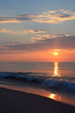 Sunrise Over Ocean with Breaking Waves. The sunrises over the ocean on a summer morning Stock Image